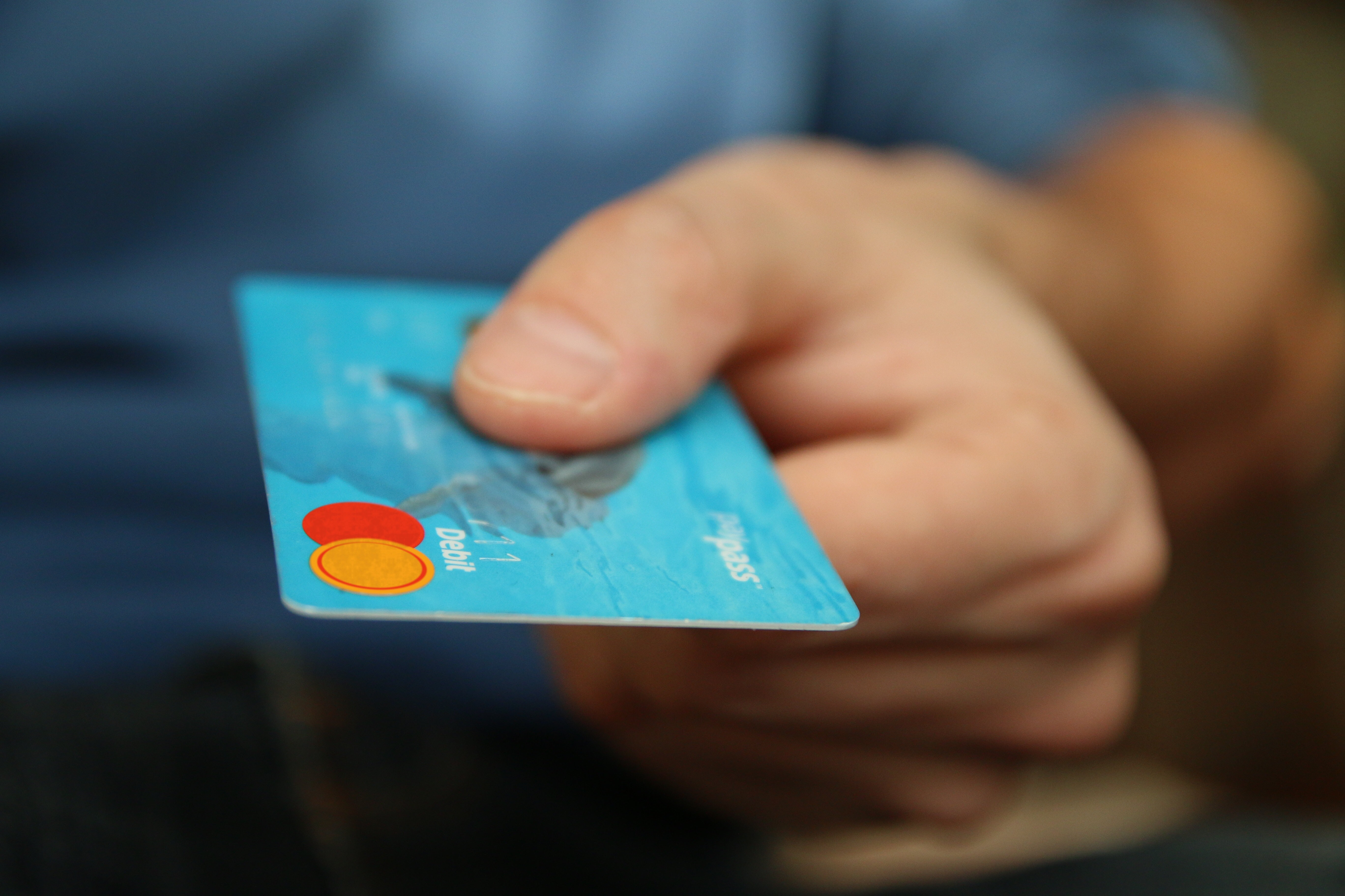 Man holding  a credit card to pay for a purchase