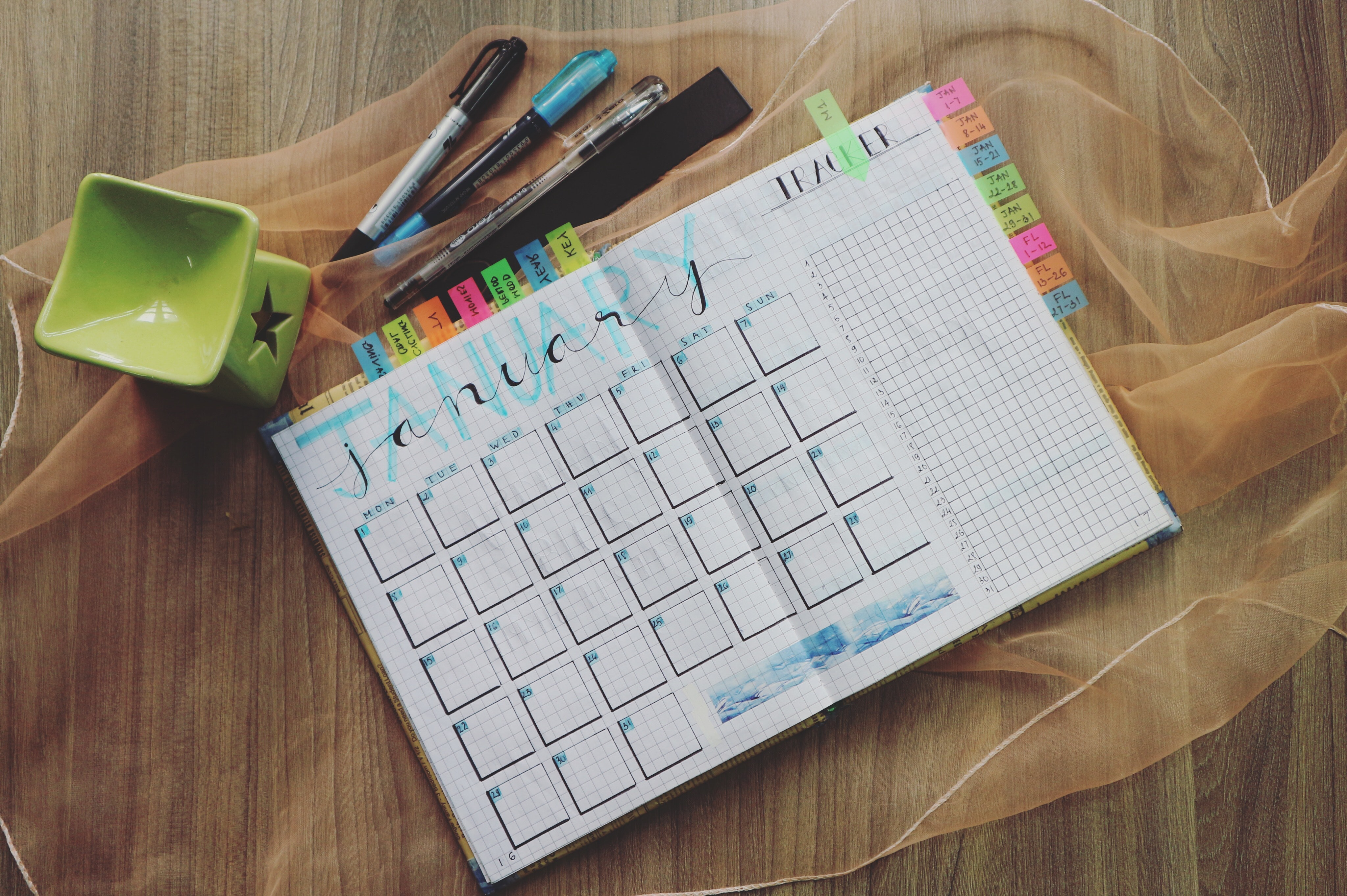 Colorful monthly planner and pens