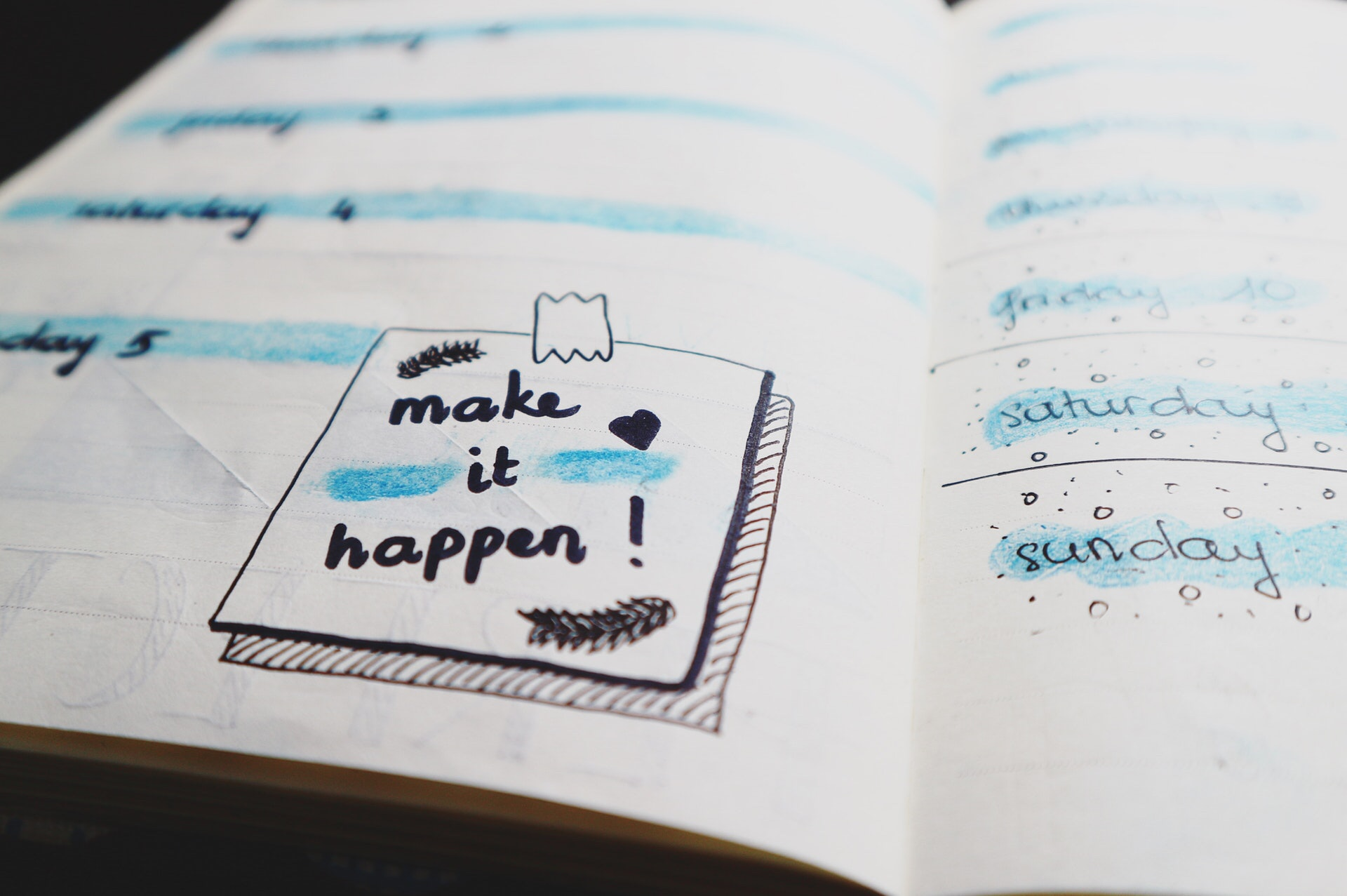 Colorful planner with a sticky note saying make it happen