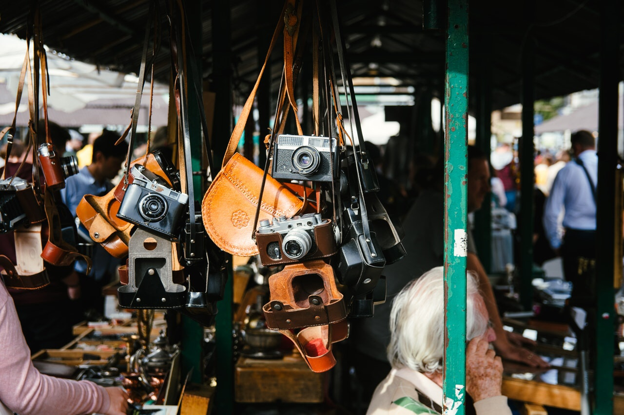 Vintage cameras being sold at an outdoor market
