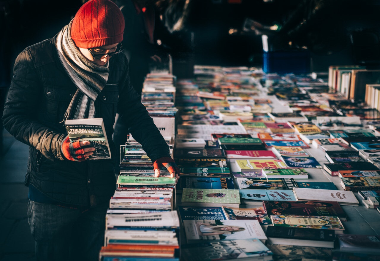 Man buying books at a flea market