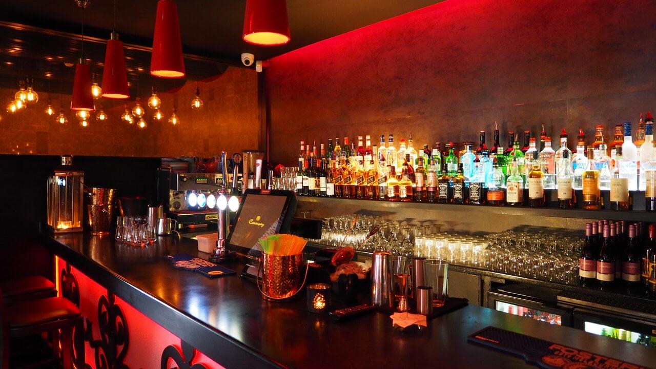 A bar with liquor bottles