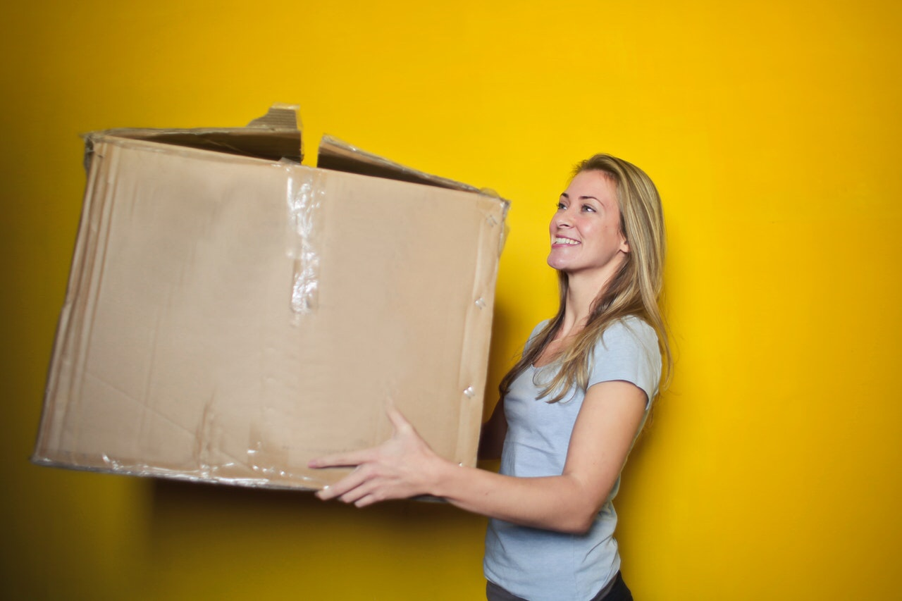 Woman holding large package