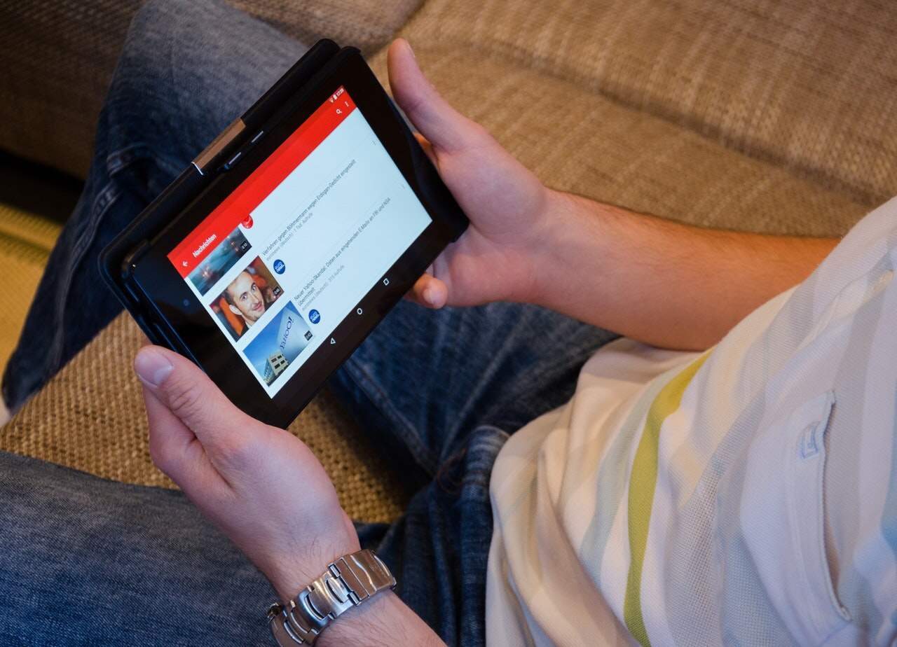 Man watching YouTube on a tablet
