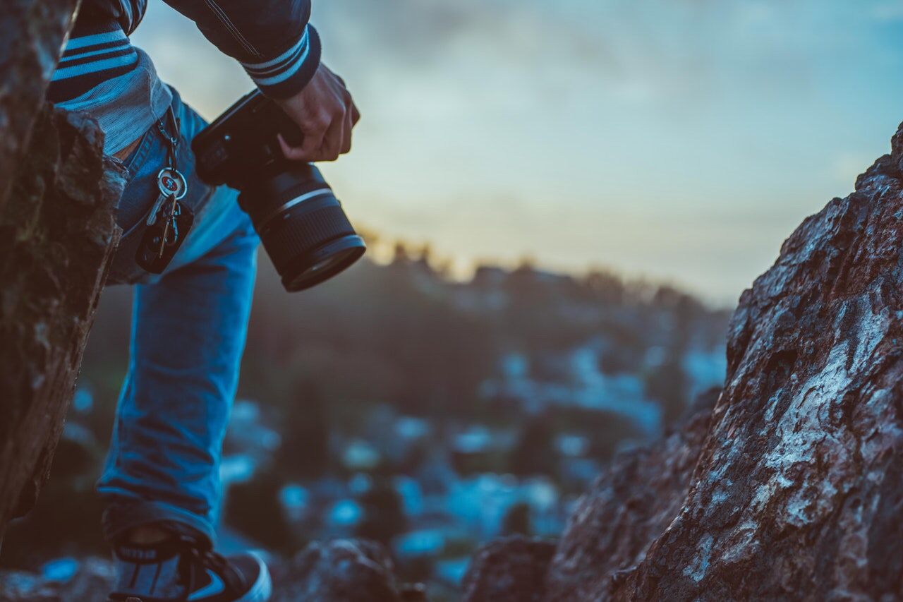 Man holding camera on a mountain