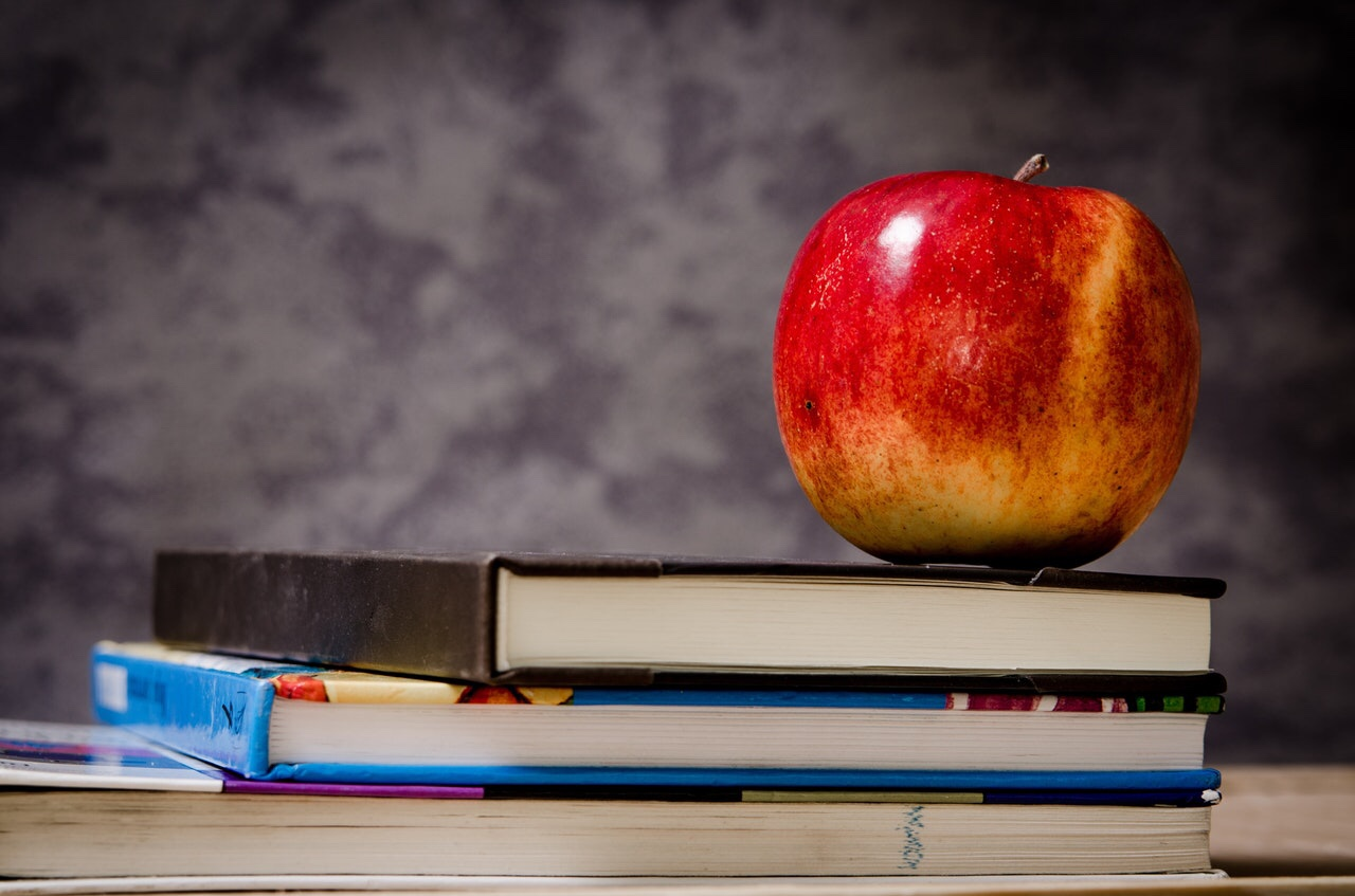 An Apple sitting on books