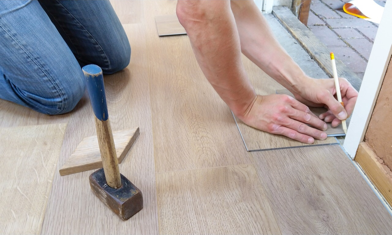 Man placing floor tiles