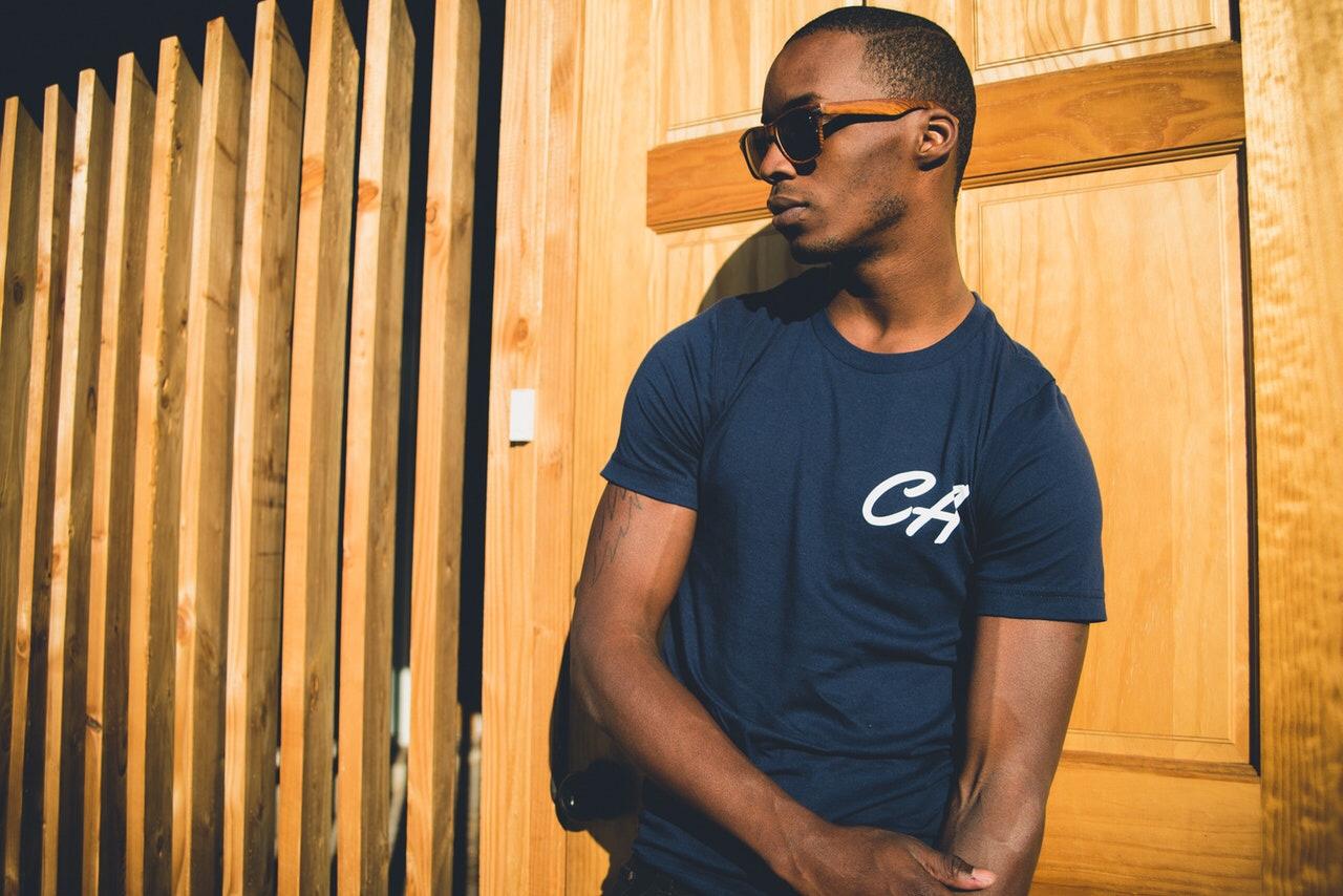 Man wearing t-shirt and sunglasses