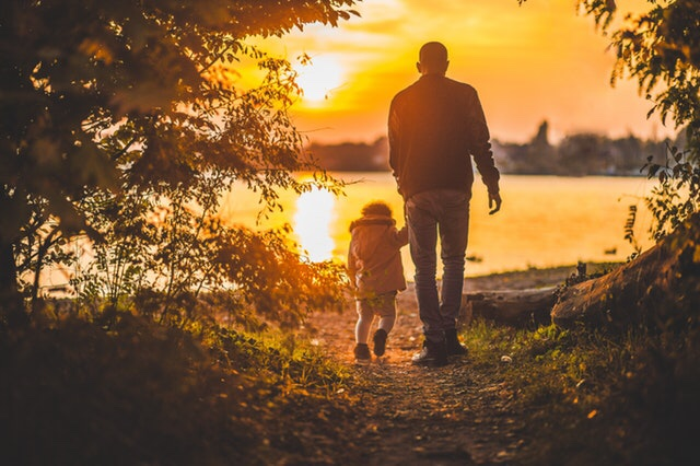 Man walking with son